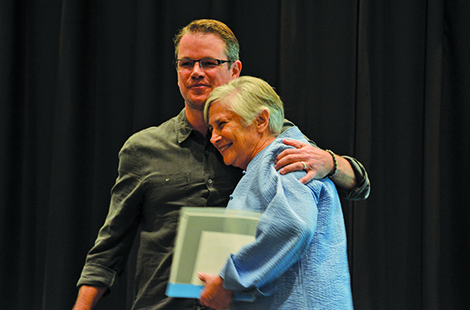 Photo of Matt Damon embracing Dianne Ravitch.