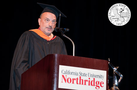Photo of Photo of Steven Stepanek at Cal State Northridge podium speaking.