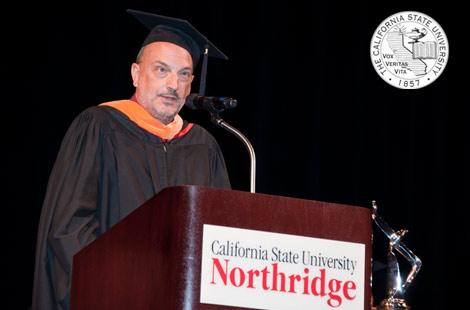 Photo of Steven Stepanek at Cal State Northridge podium speaking.