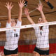 Photo of two CSUN women's volleyball players.