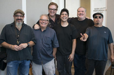 Photo of Los Lobos band members with General Manager Sky Daniels inside the KCSN radio station