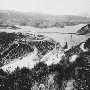 A black-and-white photo of the St. Francis Dam and resevoir