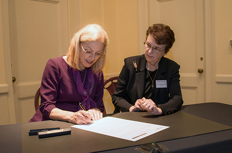 CSUN President Dianne F. Harrison signing an agreement with the Dean and Chief Executive Officer of Southwestern Law School