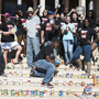 Members of Unified We Serve pose with food items on the steps of the Delmar T. Oviatt Library