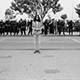 Photo of a man surrounded by police at a 1971 war protest at CSUN