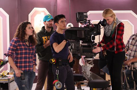 CSUN film students work with camera.