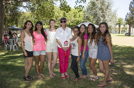 President Harrison with students at picnic.