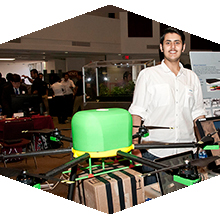 CSUN Engineering student with drone he invented.