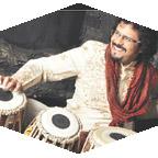 Man plays Indian drums