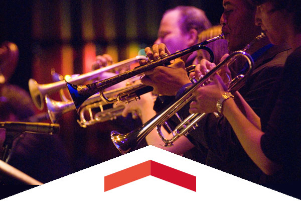 Three CSUN jazz musicians play trumpets.