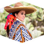 Woman wearing Mexican clothing and hat.
