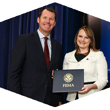 Jenny Novak accepts award from White House official
