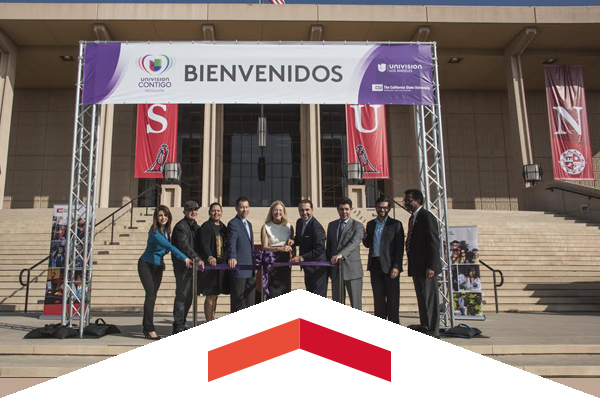 CSUN administration and Univision officials pose for a photo on the stairs of the overt library