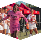 Woman kicking a soccer ball