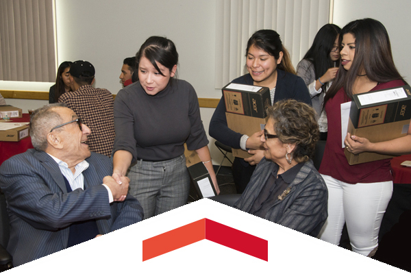 The Nazarian family presented 50 CSUN business students with laptops.