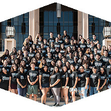 BUILD PODER students stand for a group photo on the steps of the Oviatt library.