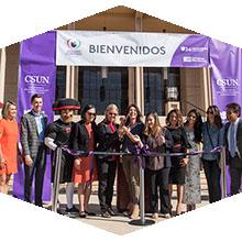 Students receive scholarship checks at Feria de Educación.
