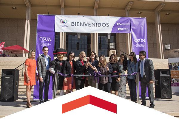 A group ribbon cutting to begin Feria de Educación.