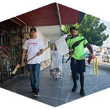 Volunteers help clean up Reseda Boulevard.