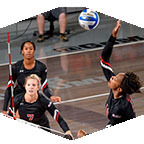 Women's volleyball action.