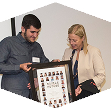 Bridge to the Future scholars presented President Harrison with a composite of their cohort as a thank you.