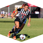 CSUN women's soccer forward Cynthia Sanchez runs from a defender.