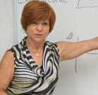 An instructor at the whiteboard.