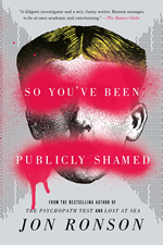 Book cover shows a face with red paint splashed across the eyes and mouth.