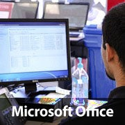 A man using a computer with the words Microsoft Office written across the image.