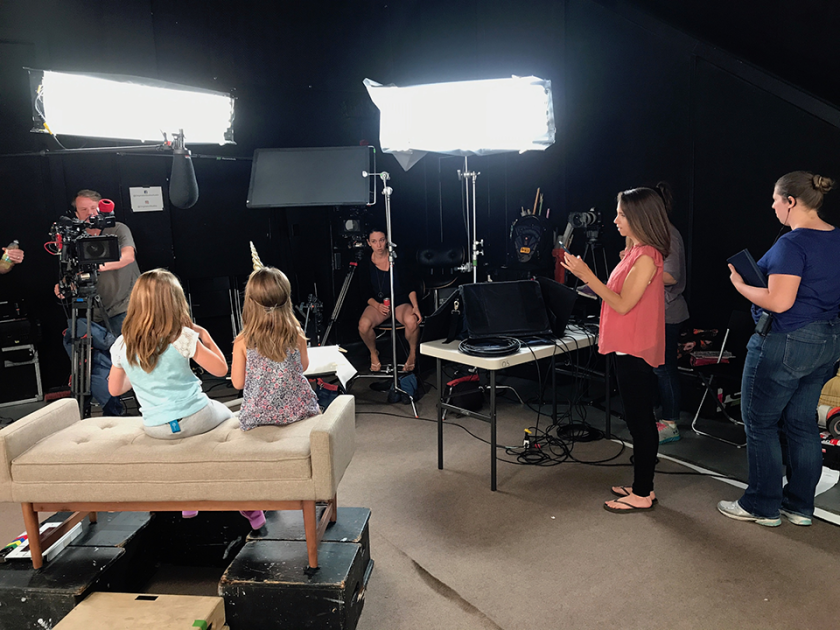 A behind-the-scenes photo from the A&E special Deaf Out Loud features CSUN alumni Sheena McFeely and her husband Manny Johnson, with their daughters, Ivy and Shaylee. Photo courtesy of Sheena McFeely.