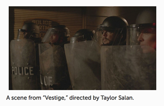 Still from film Vestige showing a police line holding shields